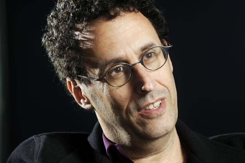 """FILE - In this April 30, 2009 photo, Tony Kushner is shown during a break from rehearsal of his new play at the Guthrie Theatre in Minneapolis, Minn.,  Kushner won a Pulitzer Prize for """"Angels in America,"""" his epic play about the AIDS epidemic, and is a New York literary fixture who has received more than a dozen honorary degrees from American colleges and universities.  So it was a shock when the Board of Trustees of the City University of New York voted last month to withhold a promised honorary degree after a trustee said the playwright was anti-Israel. CUNY later backtracked under a barrage of criticism, and Kushner will accept his degree on Friday, June 3, 2011. (AP Photo/Craig Lassig)"""