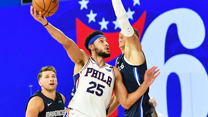 Ben Simmons is pictured shooting a hook shot against the Dallas Mavericks.