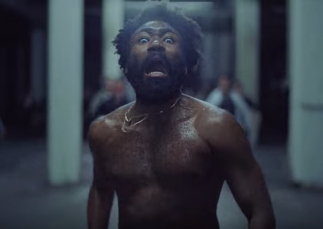 "Donald Glover was both the host and musical guest of last night's SNL, and in the midst of a number of sketches on Star Wars, Migos, and Kanye, the rapper and Atlanta star took the opportunity to debut a new Childish Gambino song. Titled ""This Is America,"" the song features Young Thug, 21 Savage, Quavo,…"