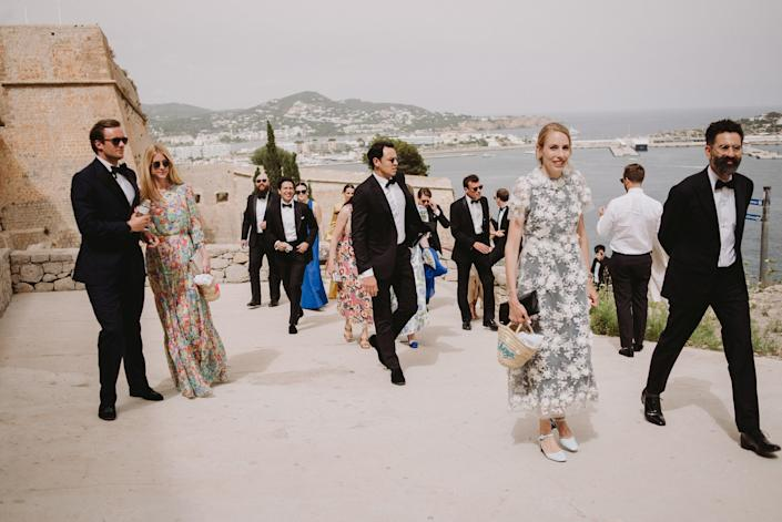 Our elegant friends arriving to the Cathedral. Old Town is the highest point in the area, and there is the best view of Ibiza. I loved how so many friends carried the Ibiza baskets I made for the Welcome Party—it was the new wedding accessory!