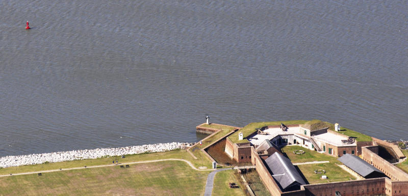 This March 6, 2012, photo provided by the U.S. Army Corps of Engineers, shows a buoy at left, near to Old Fort Jackson, marking the shipwreck of the CSS Georgia, a Confederate warship that sank in the Savannah River nearly 148 years ago in Savannah, Ga. The Army Corps of Engineers plans to spend $14 million to raise and preserve the sunken Confederate ironclad to make room for deepening Savannah's harbor. (AP Photo/U.S. Army Corps of Engineers, Billy Birdwell)