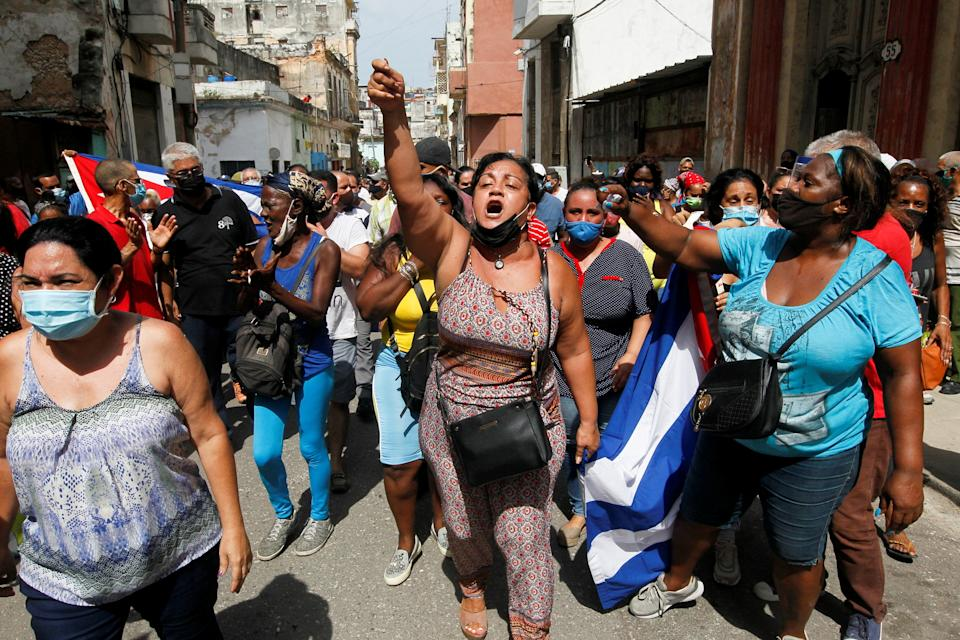 Cuban government supporters take to the streets in Havana in early July.