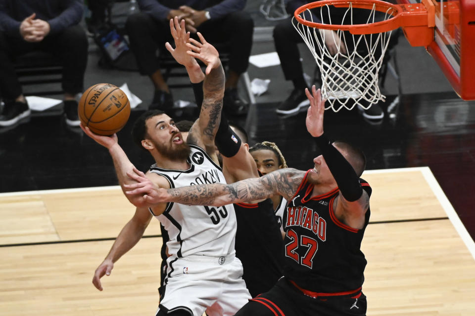 Brooklyn Nets guard Mike James (55) shoots pst Chicago Bulls center Daniel Theis (27) during the second half of an NBA basketball game Tuesday, May 11, 2021, in Chicago. (AP Photo/Matt Marton)