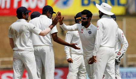 Cricket - India v Australia - Third Test cricket match - Jharkhand State Cricket Association Stadium, Ranchi, India - 17/03/17 - India's Ravindra Jadeja (2nd R) celebrates with his teammates after dismissing Australia's Nathan Lyon. REUTERS/Adnan Abidi