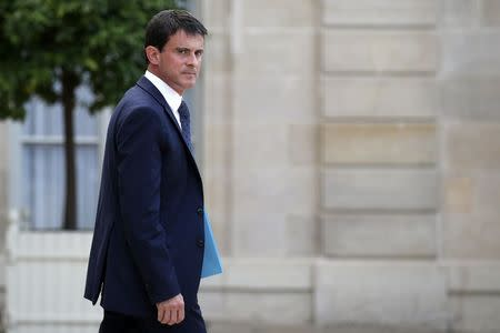 French Prime Minister Manuel Valls leaves the Elysee Palace after a meeting about Air Algerie flight AH 5017, in Paris