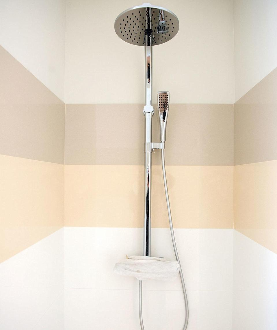 Most exposed pipe shower systems consist of a shower knob, visible pipe to the showerhead, and the showerhead. Sometimes, a handheld showerhead or other attachment is also included. The whole system mounts on the wall of the shower, putting the internal workings of the shower on full display for a subtly rugged, industrial look.
