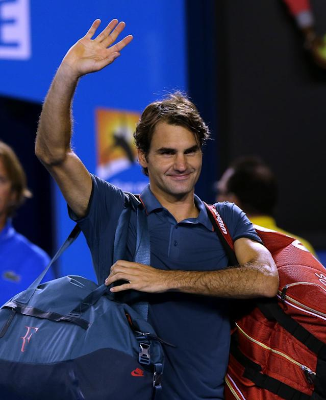 Roger Federer of Switzerland waves after defeating Andy Murray of Britain in their quarterfinal at the Australian Open tennis championship in Melbourne, Australia, Wednesday, Jan. 22, 2014. (AP Photo/Aaron Favila)