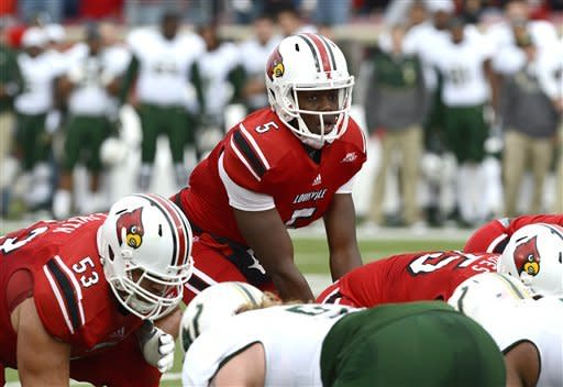 Louisville quarterback Teddy Bridgewater looks out from under center during action in an NCAA college football game against South Florida Saturday, Oct. 20, 2012 in Louisville, Ky. Louisville defeated USF 27-25. (AP Photo/ Timothy D. Easley)