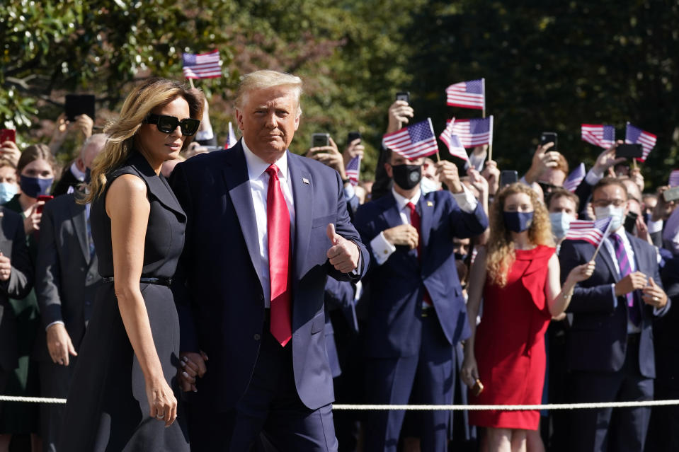 President Donald Trump and first lady Melania Trump pause as they walk to board Marine One on the South Lawn of the White House, Thursday, Oct. 22, 2020, in Washington. Trump is headed to Nashville, Tenn., for a debate. (AP Photo/Alex Brandon)