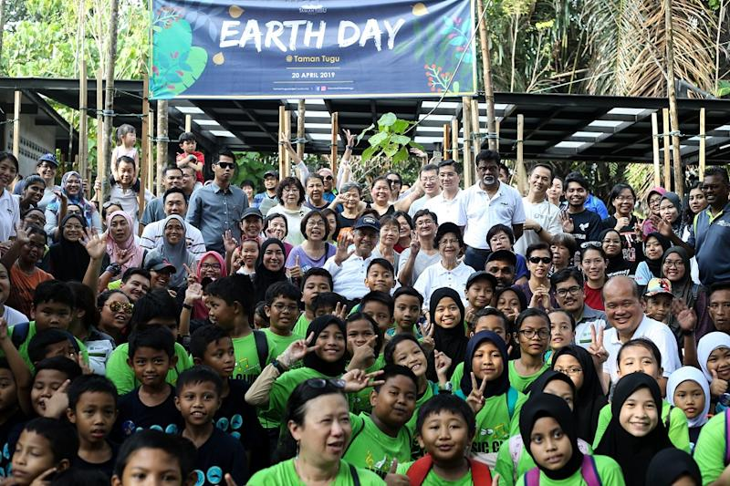 Prime Minister Tun Dr Mahathir Mohamad and Tun Dr Siti Hasmah pose for a group picture with attendees at the Earth Day celebration at Taman Tugu Nursery in Kuala Lumpur April 20,2019.
