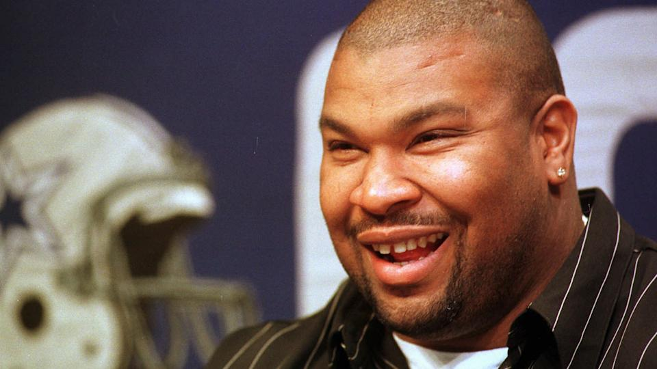 Mandatory Credit: Photo by Lm Otero/AP/Shutterstock (6494281a)ALLEN Larry Allen smiles at a news confernce anouncing a new contract with the Dallas Cowboys in Irving, Texas, .