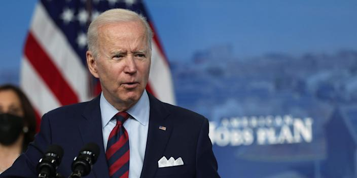 """President Joe Biden speaks as Vice President Kamala Harris listens during an event at the South Court Auditorium at Eisenhower Executive Office Building April 7, 2021 in Washington DC. President Biden delivered remarks on the administration's """"American Jobs Plan."""""""