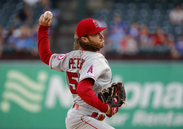 Los Angeles Angels starting pitcher Dillon Peters throws to the Texas Rangers in the first inning of baseball game in Arlington, Texas, Monday, Aug. 19, 2019. (AP Photo/Tony Gutierrez)