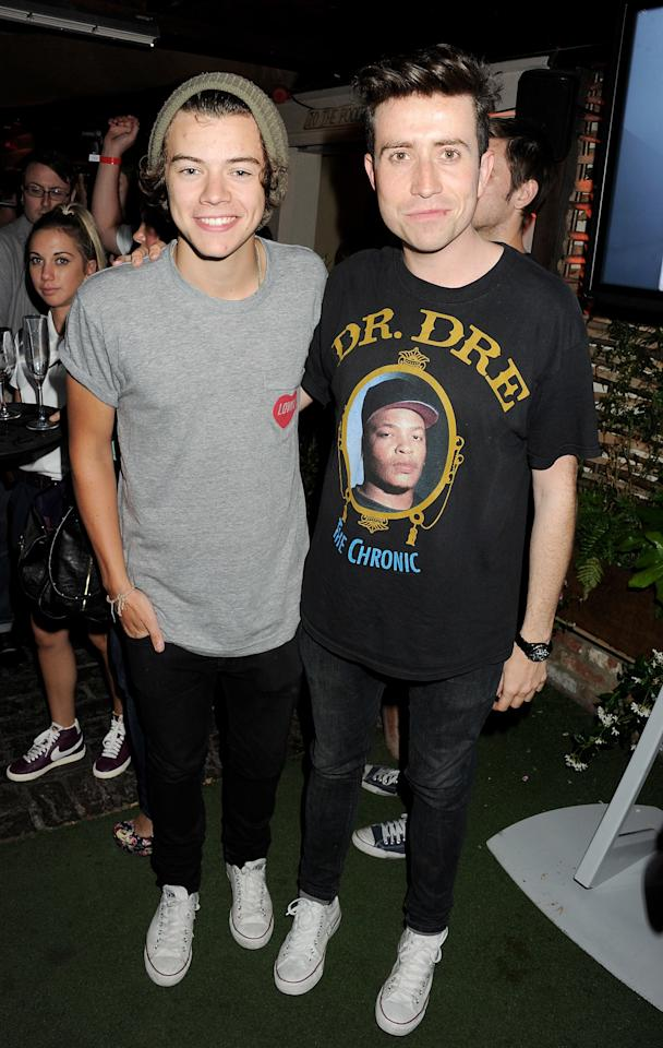<p>Styles goes casual with black jeans, a gray t-shirt and Converse while hanging out with Nick Grimshaw at the Shoreditch House in London.</p>