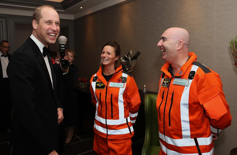 LONDON, ENGLAND - NOVEMBER 07: Prince William, Duke of Cambridge shares a joke with (L-R) Doctor Flora Bird, Consultant in emergency medicine at the Royal London Hospital and Paramedic Steve Jones about how clean their uniforms are, as he attends the London's Air Ambulance Charity gala at Rosewood London on November 07, 2019 in London, England. Prince William is Patron of London's Air Ambulance Charity's 30th Anniversary Campaign. (Photo by Chris Jackson - WPA Pool/Getty Images)