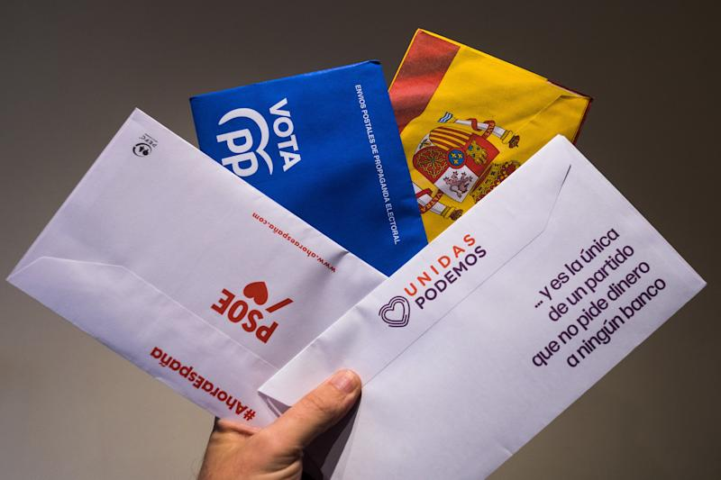 MADRID, SPAIN - 2019/11/07: In this photo illustration, the hand of a man showing postal mail of some of the main Spanish political parties (PSOE, PP, VOX, Unidas Podemos) that contains the ballots to vote in the next general elections that will take place on November 10 in Spain. (Photo Illustration by Marcos del Mazo/LightRocket via Getty Images)
