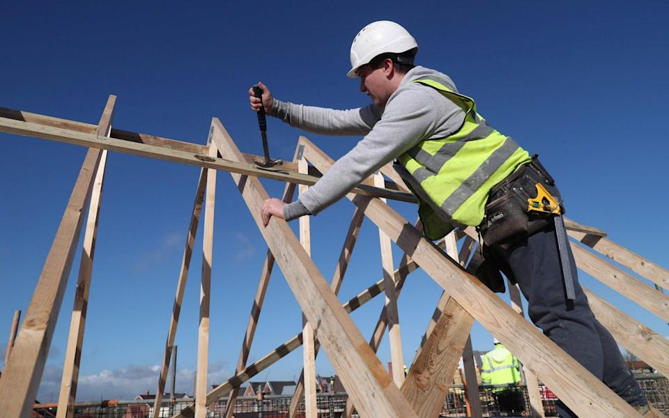 A builder working for Taylor Wimpey builds a roof on an estate in Aylesbury, Britain - Eddie Keogh/Reuters