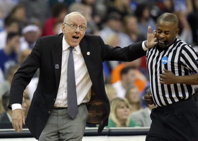 Syracuse head coach Jim Boeheim, left, accidentally hits an official while gesturing on the sideline during the first half of a regional semifinal game against Duke in the NCAA men's college basketball tournament Friday, March 23, 2018, in Omaha, Neb. (AP Photo/Charlie Neibergall)