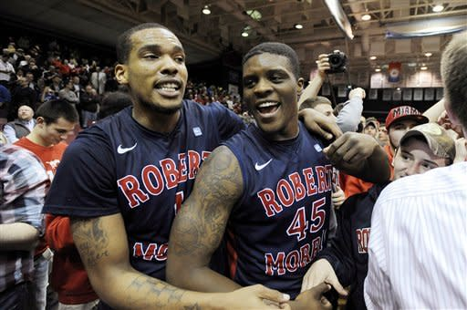 Robert Morris forward Mike McFadden (1) and forward Keith Armstrong (45) celebrate with fans following a 59-57 win over Kentucky during a first-round NIT college basketball game on Tuesday, March 19, 2013, in Coraopolis, Pa.(AP Photo/Don Wright)
