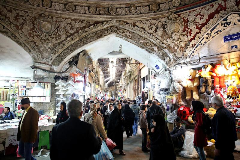 "In this picture taken on Tuesday, March 18, 2014, Iranians walk through Tehran's old main bazaar, ahead of the Iranian New Year, or Nowruz, in downtown Tehran, Iran. Nowruz which means ""New Day"" in Persian, marks the first day of spring and the beginning of the year on the Iranian calendar, which occurs exactly on the Spring Equinox, and usually begins on March 21 or the previous or following day. (AP Photo/Ebrahim Noroozi)"