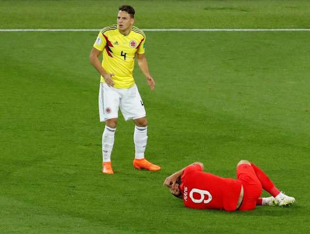 <p>Colombia's Santiago Arias reacts while England's Harry Kane is on the floor. REUTERS/Christian Hartmann </p>