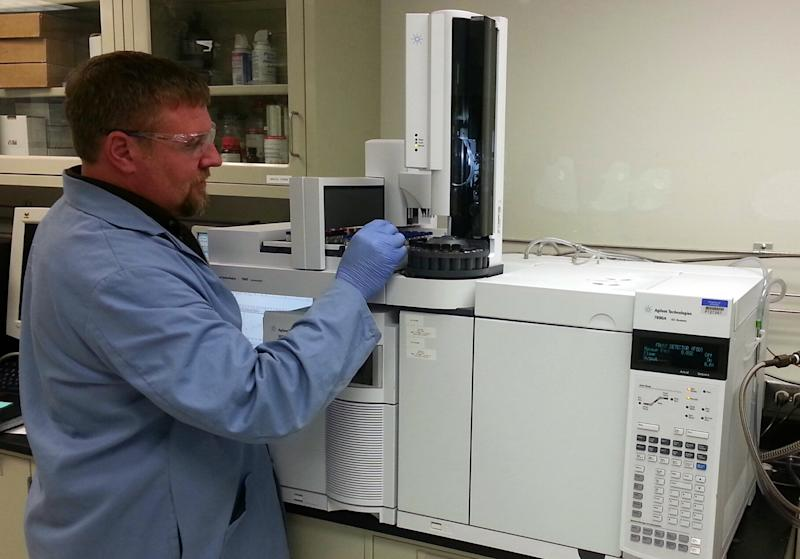 In this image provided by the Department of Energy, chemist Brian Dockendorff works on a mass spectrometer at the Pacific Northwest National Laboratory in Richland, Wash., Wednesday, Sept. 4, 2013. Three simple numbers will prove if sarin was used to gas Syrians last month: 99-125-81. Carlos Fraga, a chemist at the lab who specializes in nerve agent forensics calls those numbers sarin's fingerprint. Fraga says once chemists see those digits, they know they've got sarin. (AP Photo/Carlos Fraga)