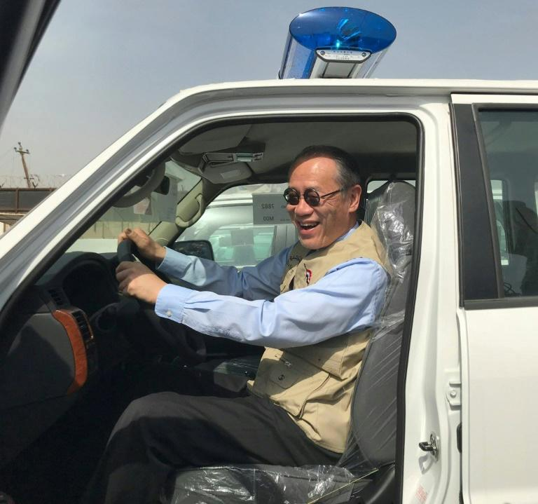 A handout picture released by the official Facebook page of the Embassy of Japan in Iraq  shows Japanese Ambassador Fumio Iwai riding in a pick-up truck on March 21, 2018