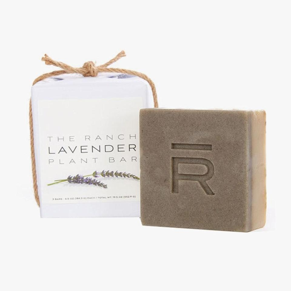 """The Ranch is one of those hallowed hotels promising life-changing wellness epiphanies. Their reputation is one that's lured Hollywood for years. The resort's treatment-based stays might not be available to all, but their products are. This lavender soap is made with ingredients harvested from The Ranch's 2-acre organic garden in the Santa Monica mountains. Purchase the calming bar as a one-off or set up a recurring order so you never run out of zen. $28, THE RANCH MALIBU. <a href=""""https://theranchmalibu.com/product/lavender-plant-bar/"""" rel=""""nofollow noopener"""" target=""""_blank"""" data-ylk=""""slk:Get it now!"""" class=""""link rapid-noclick-resp"""">Get it now!</a>"""