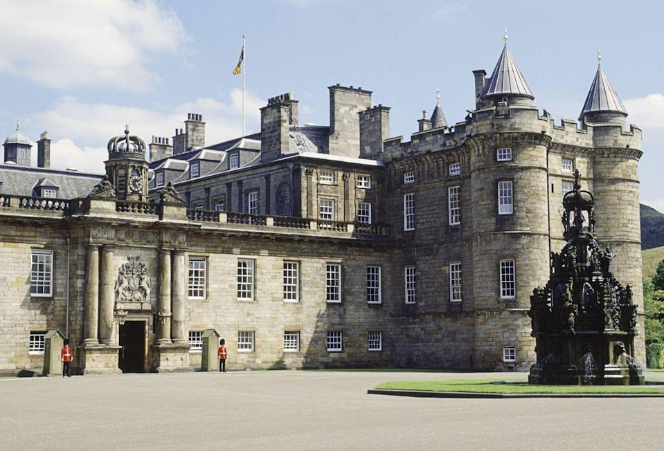 """<p>The Crown-owned official residence of the Queen when she's in Scotland began as a monastery in 1128. <a href=""""https://www.royal.uk/royal-residences-palace-holyroodhouse"""" rel=""""nofollow noopener"""" target=""""_blank"""" data-ylk=""""slk:Holyroodhouse"""" class=""""link rapid-noclick-resp"""">Holyroodhouse</a> hosts a number of national events in Scotland including Holyrood Week, when the Queen celebrates Scottish culture by visiting different regions within the country. The palace is open to the public year-round, who can visit the Holyrood Abbey, the Palace Gardens, and the State Apartments.</p>"""