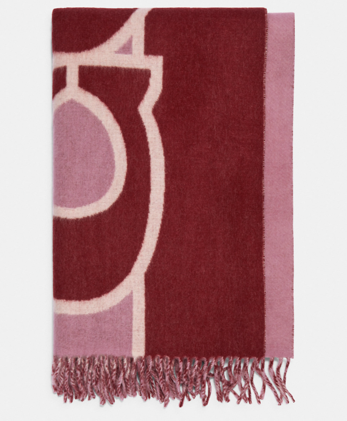 Reversible Colorblock Oversized Muffler in pink and red (Photo via Coach Outlet)