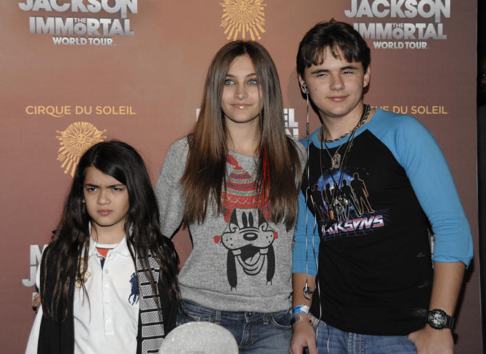 From left to right, Blanket Jackson, Paris Jackson, and Prince Michael Jackson arrive at the opening night of the Michael Jackson The Immortal World Tour in Los Angeles on Friday, Jan. 27, 2012. (AP Photo/Dan Steinberg)