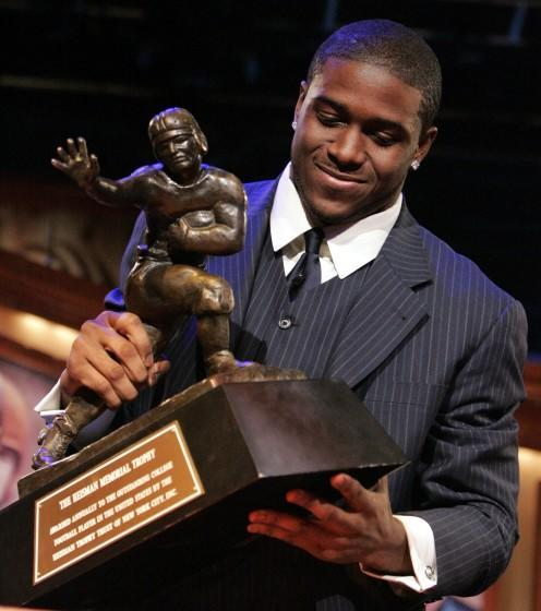 FILE - This Dec. 10, 2005, file photo shows Southern California football player Reggie Bush picking up the Heisman Trophy.