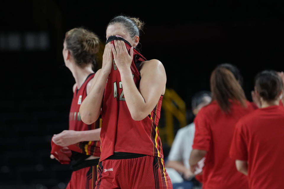 Belgium's Jana Raman (42) and teammates walk off the court after their loss to Japan in a women's basketball quarterfinal game at the 2020 Summer Olympics, Wednesday, Aug. 4, 2021, in Saitama, Japan. (AP Photo/Eric Gay)