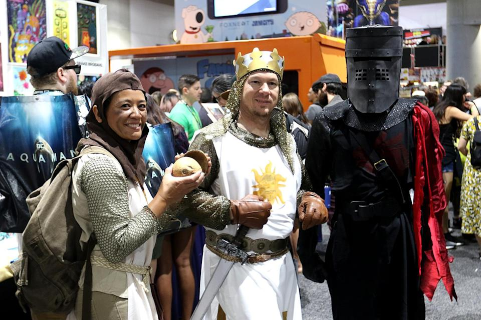 <p>Friends dress up to pay homage to <em>Monty Python and the Holy Grail</em> — complete with coconuts — at Comic-Con International on July 19, 2018, in San Diego. (Photo: Angela Kim/Yahoo Entertainment) </p>