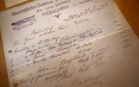 The original bill of sale for a watercolour of the old registry office in Munich by former German dictator Adolf Hitler is displayed at Weidler auction house in Nuremberg November 18, 2014.   REUTERS/Kai Pfaffenbach
