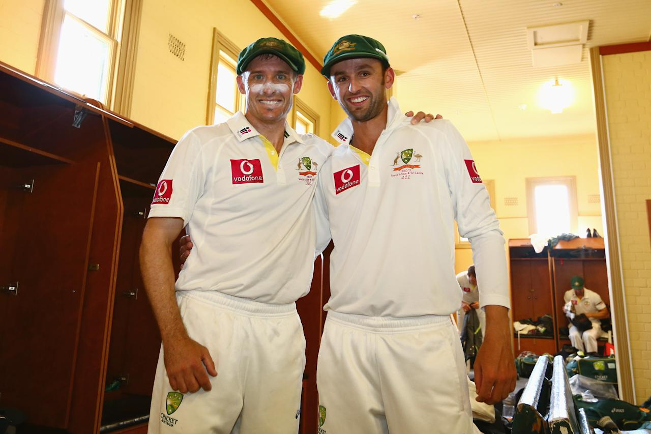 SYDNEY, AUSTRALIA - JANUARY 06:  Michael Hussey and Nathan Lyon of Australia pose in the change room after Hussey's retirement from international cricket after day four of the Third Test match between Australia and Sri Lanka at Sydney Cricket Ground on January 6, 2013 in Sydney, Australia.  (Photo by Mark Kolbe/Getty Images)