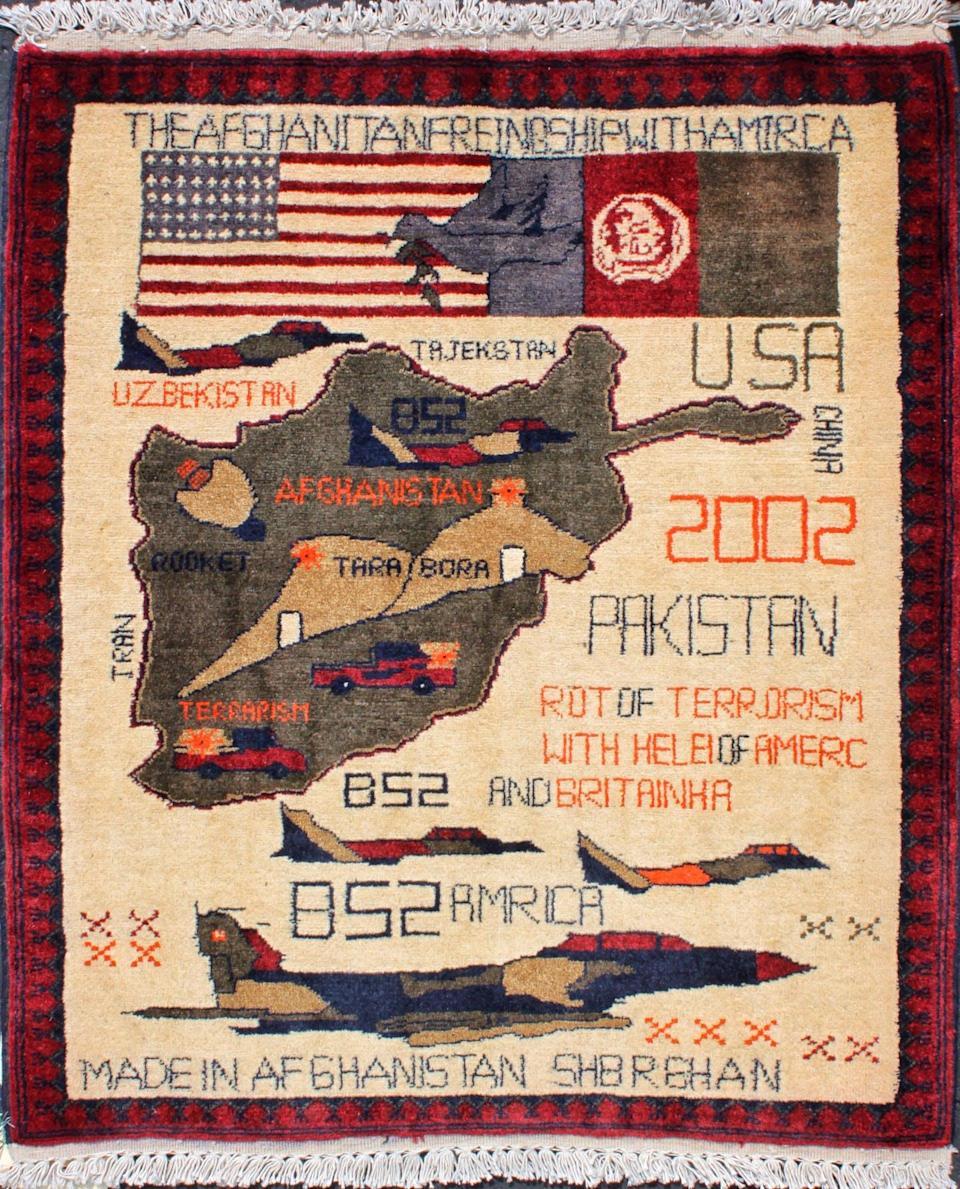 Rug featuring bomber planes and an outline of Afghanistan.