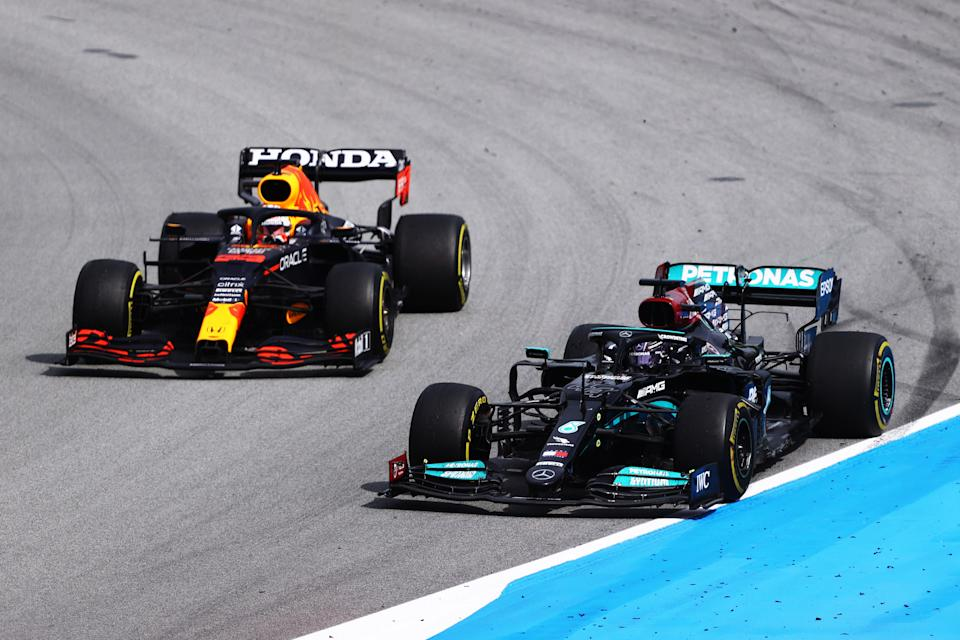 BARCELONA, SPAIN - MAY 09: Lewis Hamilton of Great Britain driving the (44) Mercedes AMG Petronas F1 Team Mercedes W12 leads Max Verstappen of the Netherlands driving the (33) Red Bull Racing RB16B Honda on track during the F1 Grand Prix of Spain at Circuit de Barcelona-Catalunya on May 09, 2021 in Barcelona, Spain. (Photo by Bryn Lennon/Getty Images)