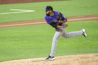 Colorado Rockies starting pitcher German Marquez works against the Texas Rangers during the first inning of an opening day baseball game Friday, July 24, 2020, in Arlington, Texas. (AP Photo/Jeffrey McWhorter)