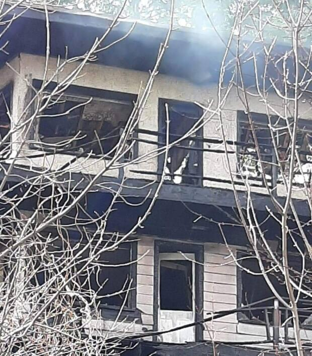 The scorched remains of an apartment building destroyed by fire on Saturday will have to be demolished, according to the fire chief.