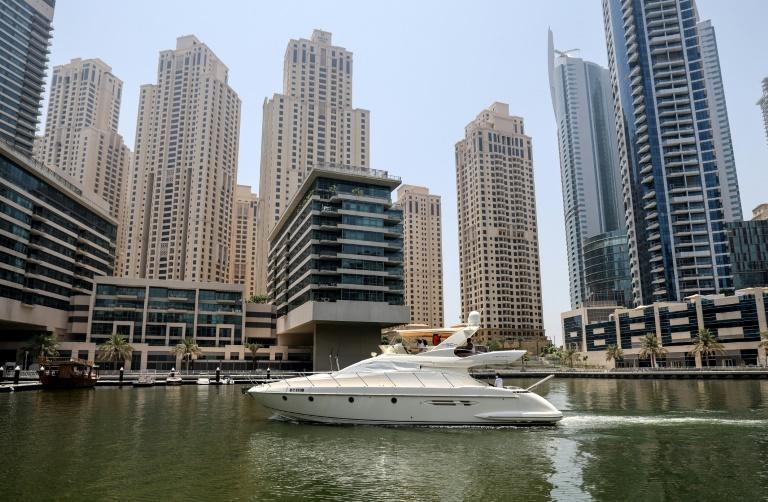 Dozens of white yachts are seen zipping through Dubai's bays, canals and islands