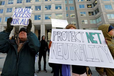 FILE PHOTO: Net neutrality advocates rally in front of the Federal Communications Commission (FCC) in Washington, U.S., December 13, 2017. REUTERS/Yuri Gripas/File Photo/File Photo