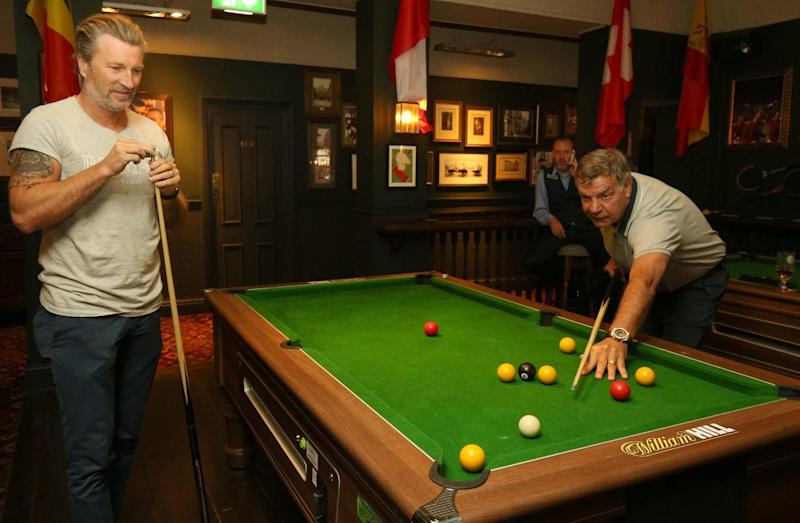 Robbie Savage (left) and Sam Allardyce play pool at the Lord Raglan Pub in London (PA)
