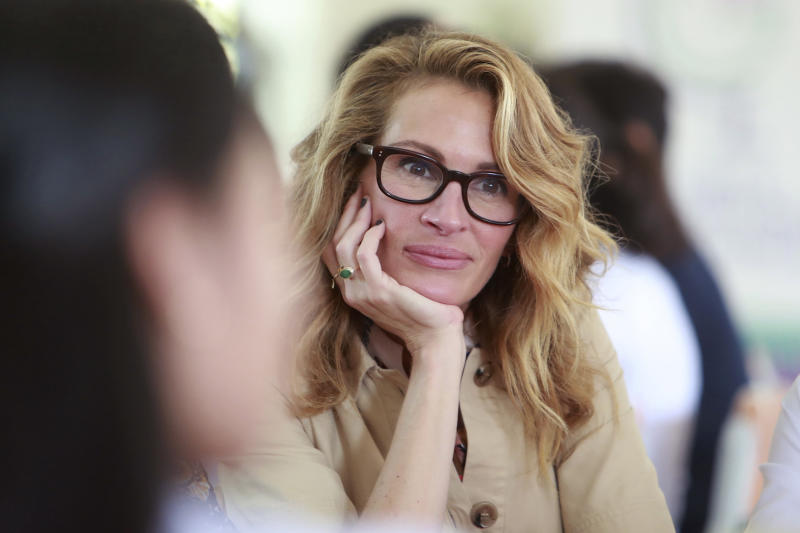 Actress Julia Roberts listens to a student at Can Giuoc high school in Long An province, Vietnam Monday, Dec. 9, 2019. Roberts is accompanying U.S. former first lady Michelle Obama on a trip to Vietnam to promote education for adolescent girls. (AP Photo/Hau Dinh)