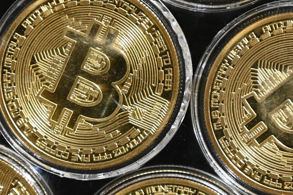 """This photograph taken on September 24, 2020 shows a physical imitation of a Bitcoin at a crypto currency """"Bitcoin Change"""" shop, near Grand Bazaar, in Istanbul. (Photo by Ozan KOSE / AFP) (Photo by OZAN KOSE/AFP via Getty Images)"""