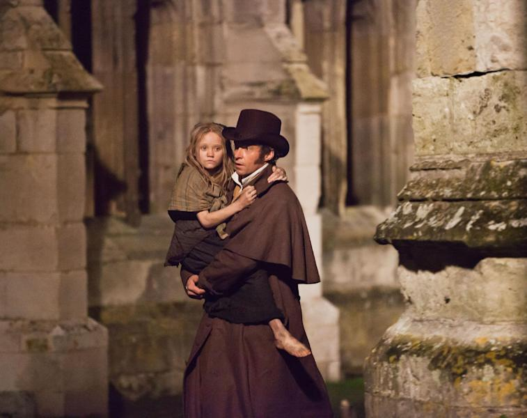 "FILE - This undated publicity image provided by Universal Pictures shows Isabelle Allen, left, as a young Cosette and Hugh Jackman as Jean Valjean in a scene from the motion-picture adaptation of ""Les Misérables,"" directed by Tom Hooper. AFI's top-10 announced Monday, Dec. 10, 2012, include Ben Affleck's Iran hostage-crisis drama ""Argo;"" Benh Zeitlin's low-budget hit ""Beasts of the Southern Wild;"" Quentin Tarantino's slavery saga ""Django Unchained;"" Tom Hooper's Victor Hugo musical ""Les Miserables;"" Ang Lee's shipwreck story ""Life of Pi;"" Wes Anderson's first-love romance ""Moonrise Kingdom;"" and David O. Russell's misfit love story ""Silver Linings Playbook,"" among other films. (AP Photo/Universal Pictures, Laurie Sparham, File)"