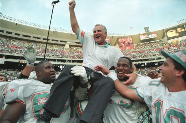 FILE PHOTO: MIAMI DOLPHINS COACH SHULA IS CARRIED OFF THE FIELD BY PLAYERSFOLLOWING RECORD WIN.
