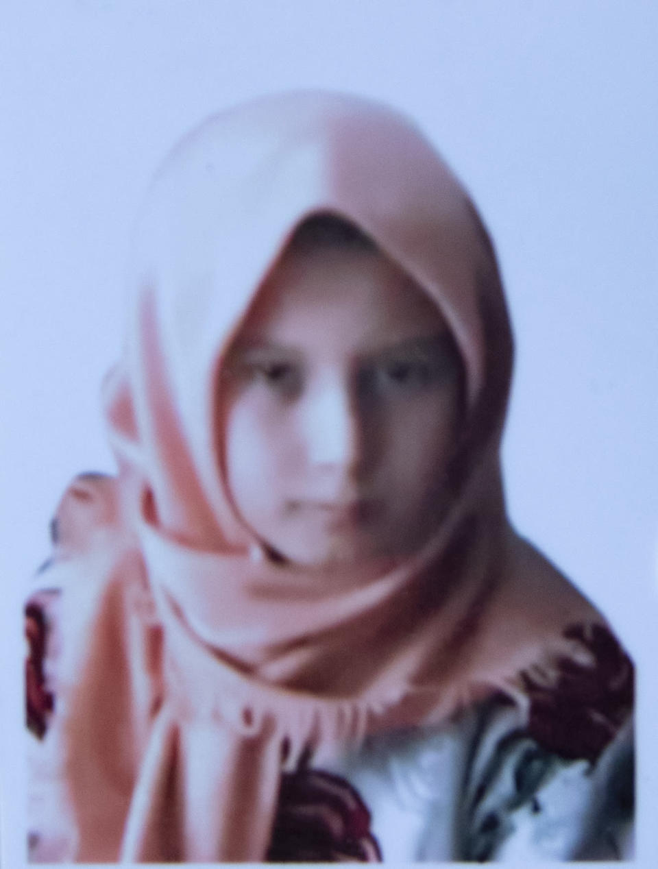 This undated photo released by the family shows Farzana Fazili who was among nearly 100 people killed in bombing attacks outside her school on May 8, 2021. Thirteen -year old Farzana Fazili was the jokester in the family said her brother Hamidullah. She too wove carpets in her spare time to earn money for her family. When she wasn't teasing her younger brother, she would help him with his homework. (AP Photo)