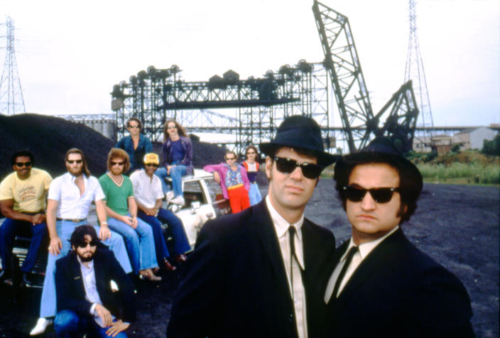 Canadian actor and screenwriter Dan Aykroyd and American actor John Belushi, with director John Landis (L) on the set of his movie The Blues Brothers. (Photo by Sunset Boulevard/Corbis via Getty Images)
