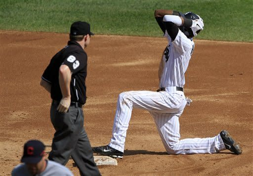 Chicago White Sox's Alexei Ramirez reacts to being called out at stealing second base by umpire Mike Estabrook during the third inning of a baseball game against the Cleveland Indians, Tuesday, Sept. 25, 2012, in Chicago. (AP Photo/John Smierciak)